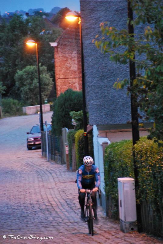 Gregg back riding the Koppenberg while dawn breaks over Belgium